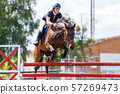 Horse rider woman on show jumping competition 57269473