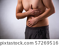 Young man suffering from stomachache 57269516