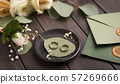 Creative Wedding rings composition on small plate on wood 57269666