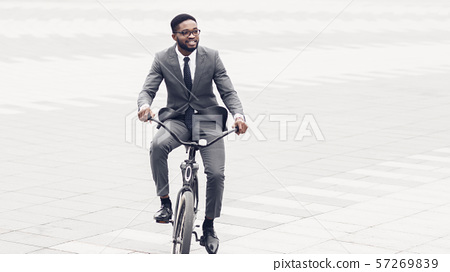 Active businessman riding bicycle on the way to job 57269839