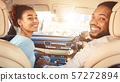 Young afro couple enjoying road trip by car 57272894