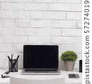 Close up of office laptop with blank screen for advertisement 57274019