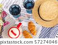 Stylish picnic on the green lawn. Fresh croissants 57274046