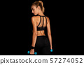 Fitness Girl Working Out With Dumbbells, Black Background, Studio Shot 57274052