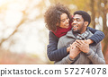 Serene couple in love walking in autumn park 57274078
