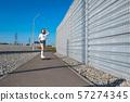stylish girl in white stockings ride on longboard 57274345