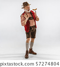 Portrait of Oktoberfest man, wearing the traditional Bavarian clothes 57274804