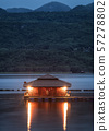 Wooden raft resort shining with hill on lake in 57278802