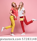Two Fashion woman having fun, Trendy summer outfit 57283148