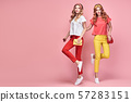 Fashion. Two happy woman laughing jump Having Fun 57283151