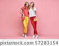 Two Fashion woman having fun, Trendy summer outfit 57283154