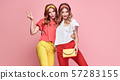 Two Fashion woman having fun, Trendy summer outfit 57283155