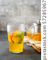 A glass of fruit tea on grey background 57285967