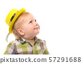 Little Funny boy in shirt and funny hat. 57291688