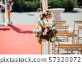 Decoration wedding arch with white and pink flowers on a green natural background. 57320972