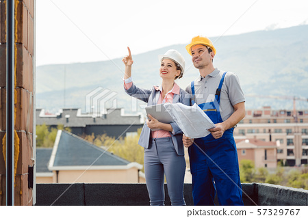 Architect and builder developing ideas for construction project 57329767