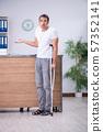 Young man at hospital reception desk 57352141
