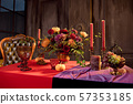 Halloween table festively decorated composition of flowers candles candles pumpkin glasses with wine 57353185
