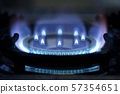 Kitchen gas stove in a kitchen burning gas.  57354651