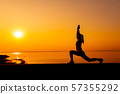 Silhouette sporty woman with sunset.  57355292