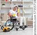 Disabled man with vacuum cleaner at home 57355718