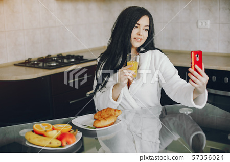 girl in a white dressing gown 57356024
