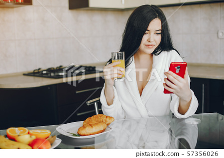 girl in a white dressing gown 57356026