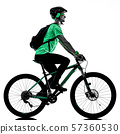 tenager boy mountain bike bking isolated shadows 57360530