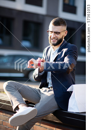 Businessman using his smart watch while checking notifications 57361053