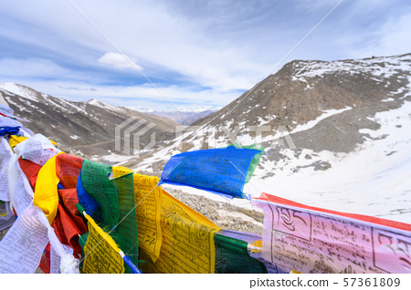 Snow mountain view with tibetan prayer flag on hill 57361809