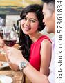 Happy woman enjoying a drink 57361834
