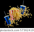 Set of paper striped bucket with popcorn and cup of soft drink isolated on black 57362419