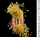 Flying popcorn from striped bucket isolated on black background 57362448