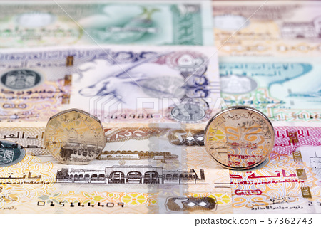 Coins from United Arab Emirates on a background of banknotes 57362743