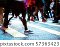 People moving in crowded city street 57363423