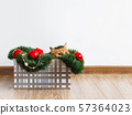Cute ginger cat lying in box with Christmas and New Year decorations. 57364023