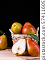fresh pears with leaves in a basket on wooden 57411605