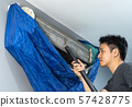 man using vacuum cleaner to cleaning air 57428775