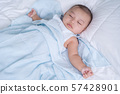 baby sleeping on a bed at home 57428901