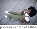 Young and beautiful black girl talking on her cell 57434658