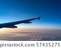 view of aircraft wing silhouette and dark blue sky 57435275