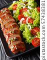 Tasty pork tenderloin in honey-garlic sauce served 57438381