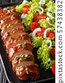 Tender cooked pork tenderloin in honey-garlic 57438382