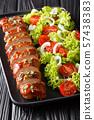 Sliced baked pork tenderloin in honey-garlic sauce 57438383