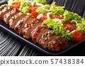 Juicy baked pork tenderloin in honey-garlic sauce 57438384