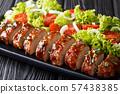 festive dish of baked pork tenderloin in 57438385