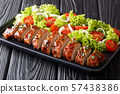 Delicious baked pork tenderloin with rosemary in 57438386