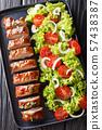 Tasty pork tenderloin in honey-garlic sauce served 57438387