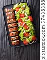 Baked pork tenderloin in honey-garlic sauce with 57438388
