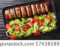 Tender cooked pork tenderloin in honey-garlic 57438389